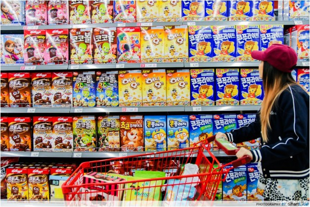 The Smart Local - Kimberly shopping at Lotte Mart viewing a wall of Korean cereal