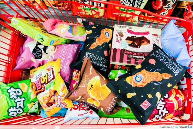The Smart Local - Kimberly shopping at Lotte Mart with a bunch of Korean snacks