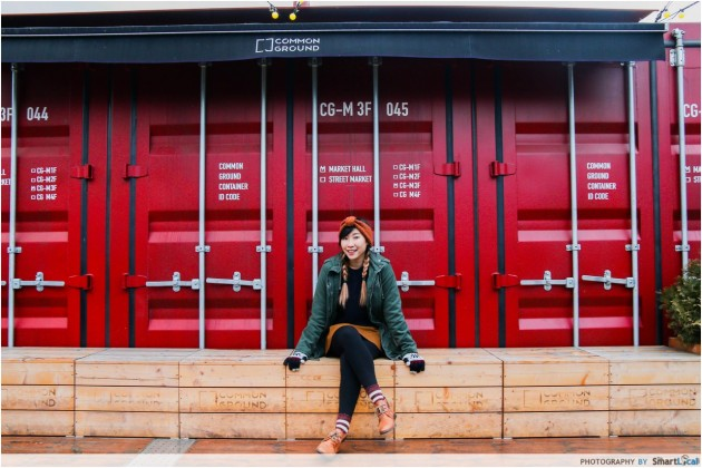 The Smart Local - Kimberly posing in front of a red common Ground container