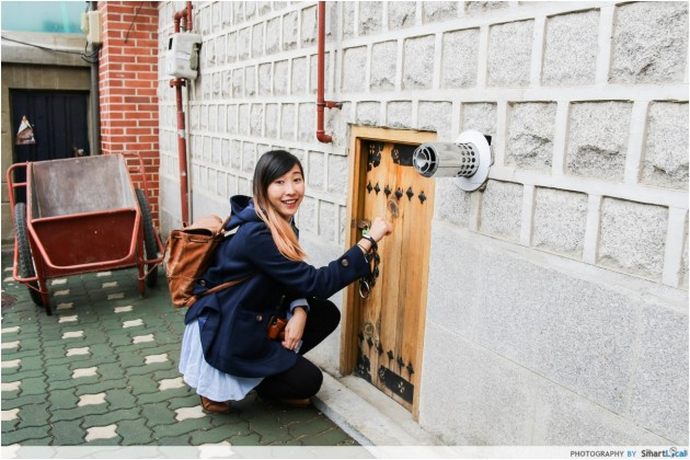 The Smart Local - Kimberly exploring the doors mainly used for servants in a traditional Hanok