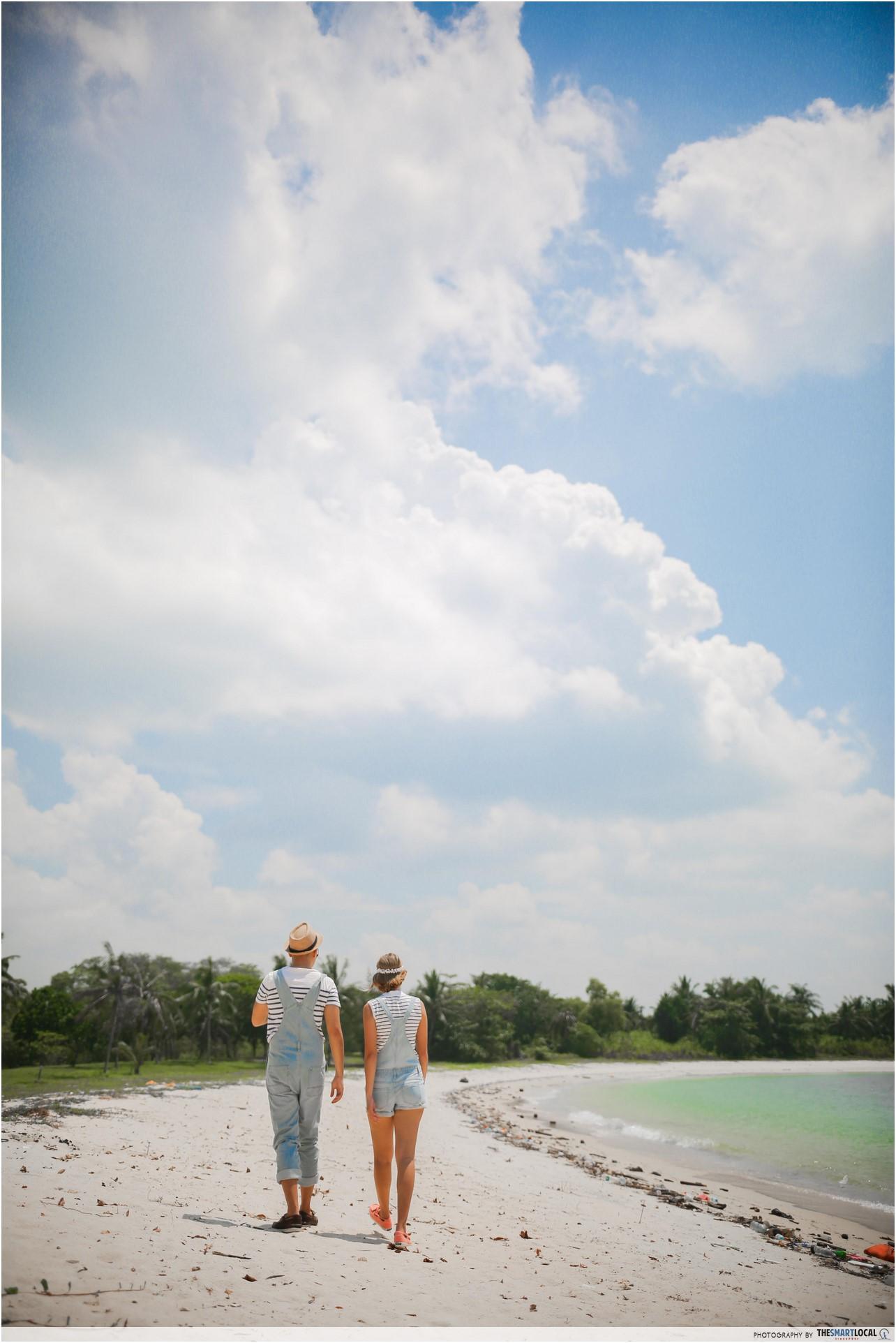Beatrice And Fauzi Strolling On Lazarus Island Beach