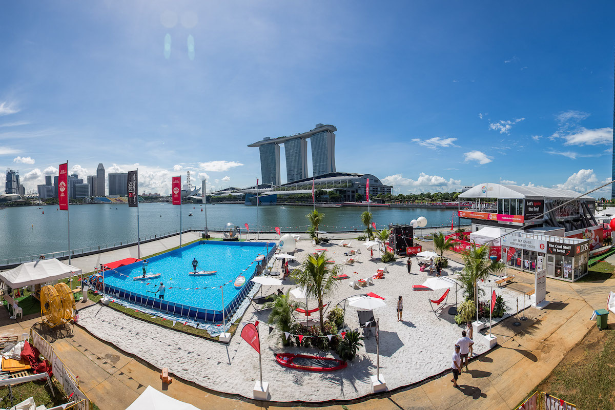 This Pop Up Beach Is Hening At Marina Bay With A 5 Y Tall Water Slide Thesmartlocal