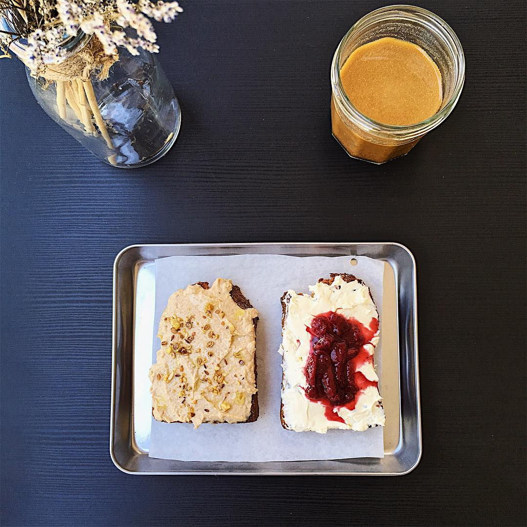 The Bakery's Nut Butter Honey and Sea Salt Toast, and Sage Cream Cheese and Berry Compote Toast