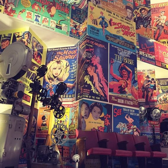 The gallery walls are lined with technicolour vintage movie posters