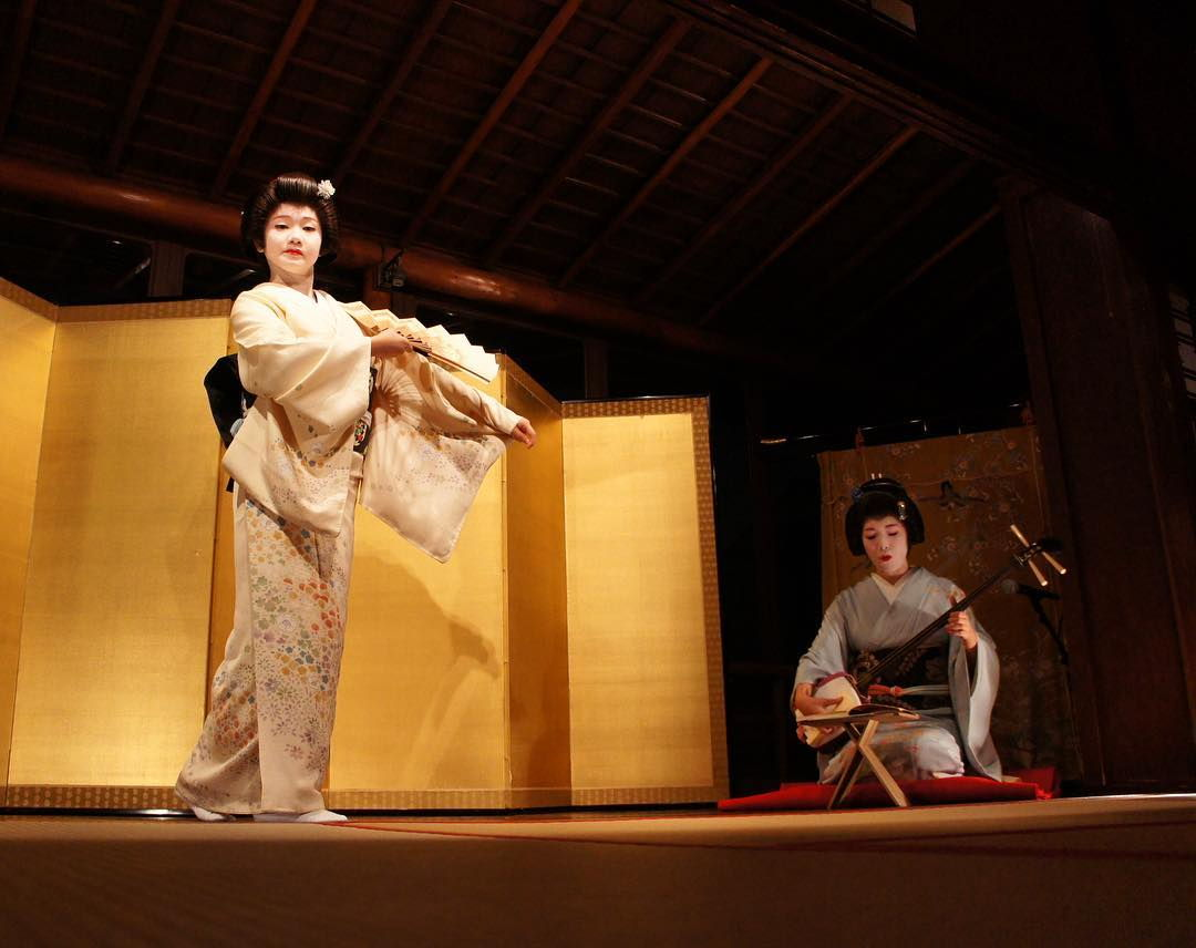 Geisha performance in teahouse.