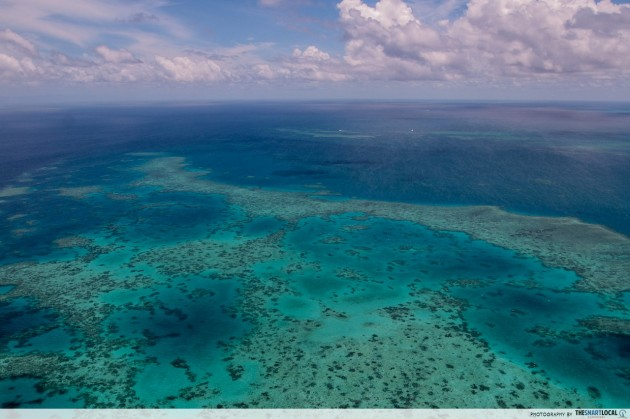 hover above the great barrier reef helicopter view