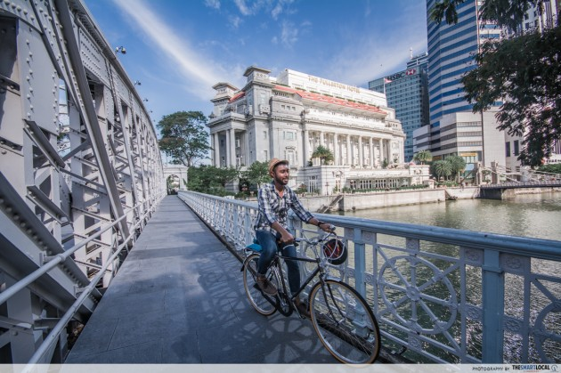 cycling with the fullerton hotel in the background