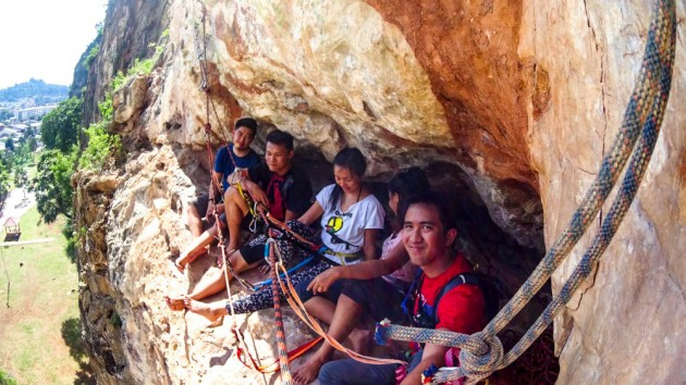 take a break in a small cave while climbing