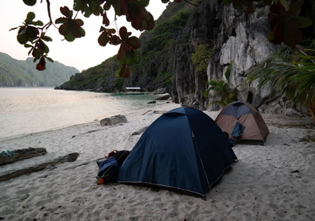 camp overnight on the beach after a day of climbing