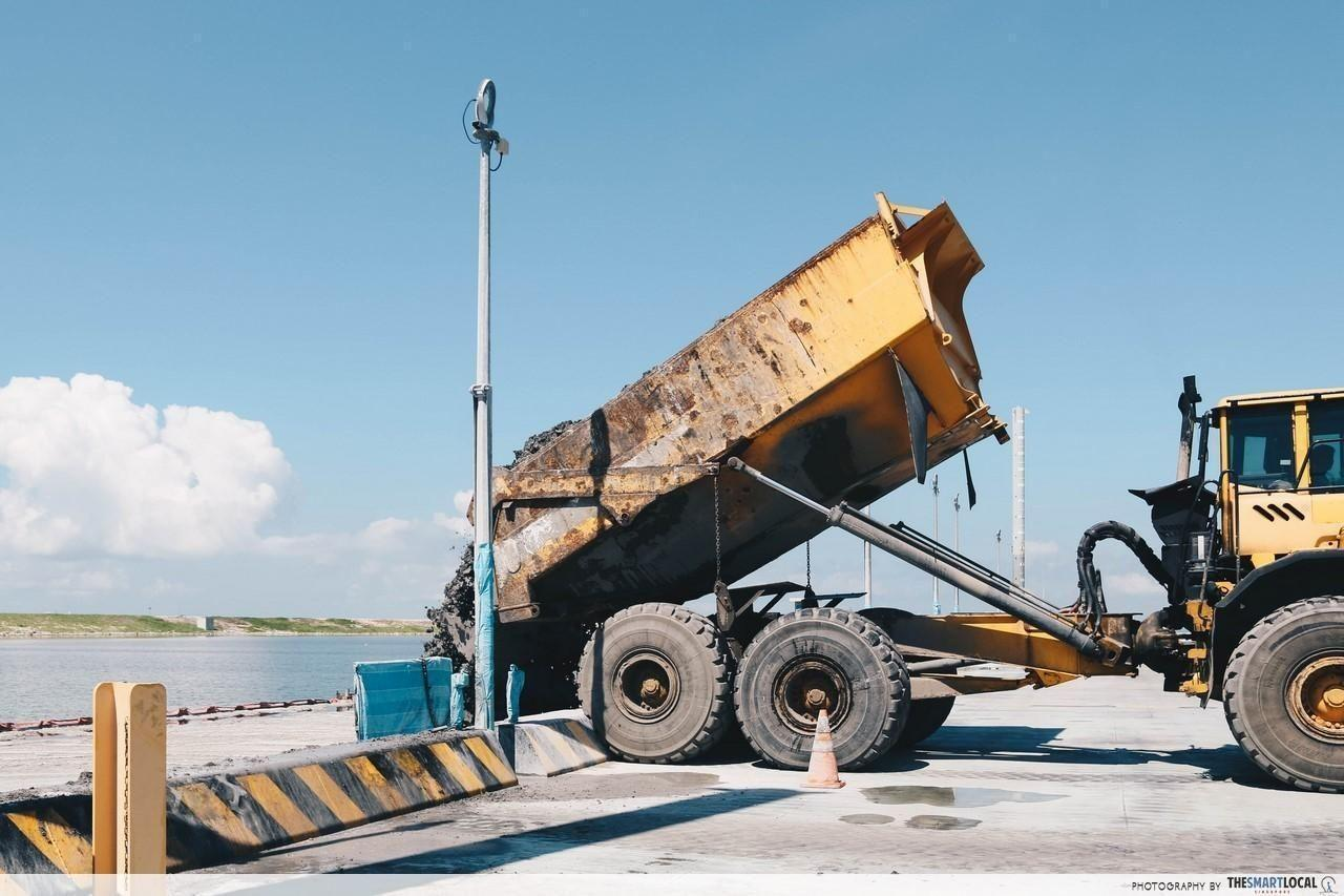 Incineration ash being tipped into the giant landfill cell from the Floating Platform