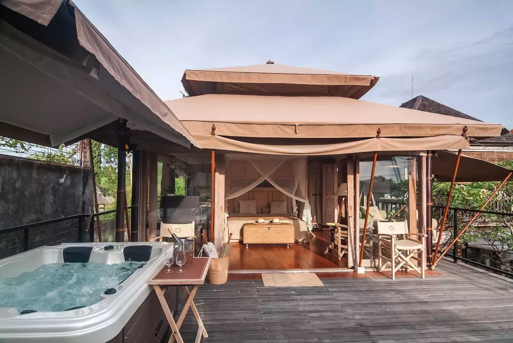 private jacuzzi in a glamping tent at kuta utara