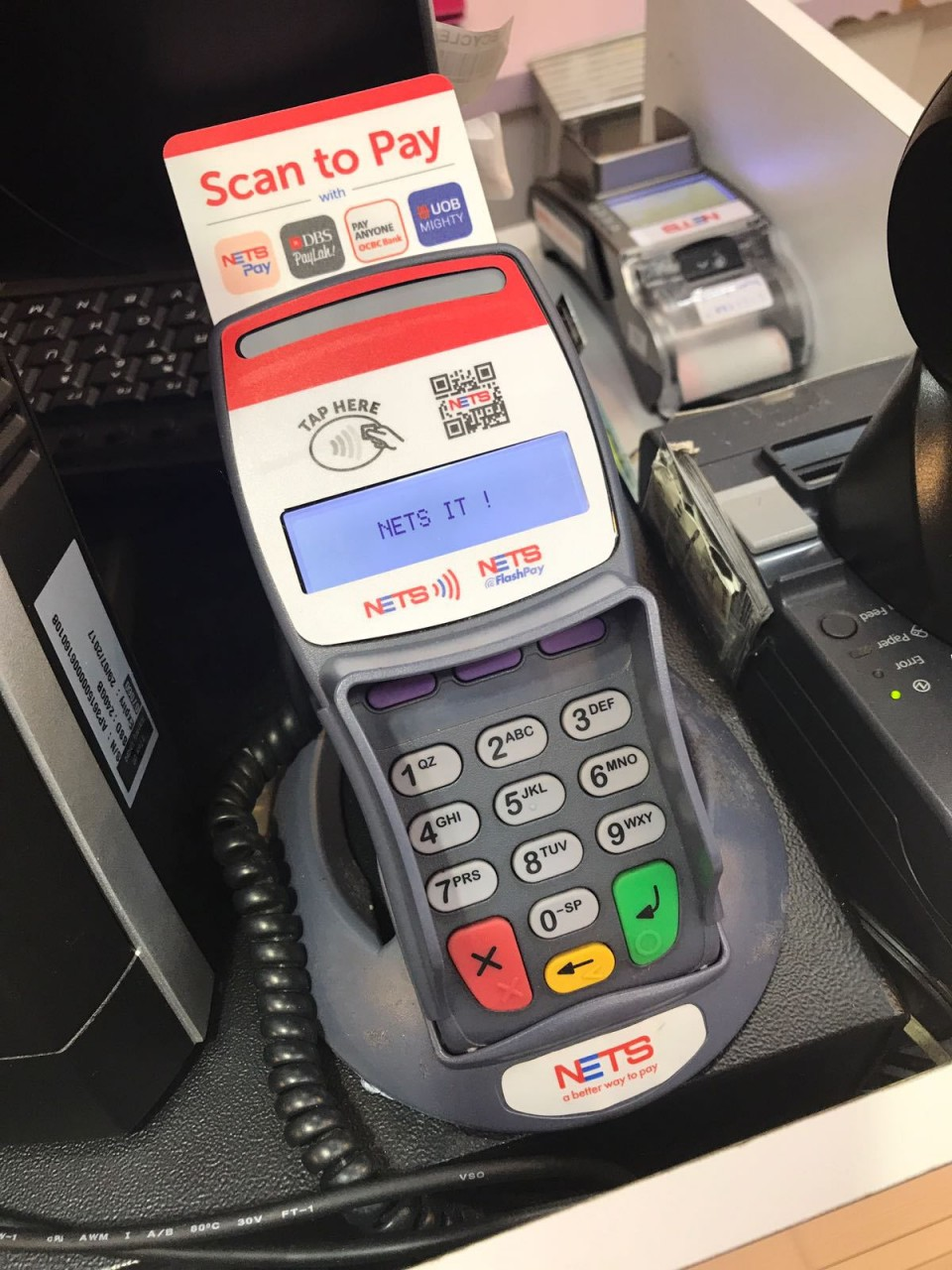 "Just look out for the ""Scan to Pay"" NETSPay merchant sign above!"