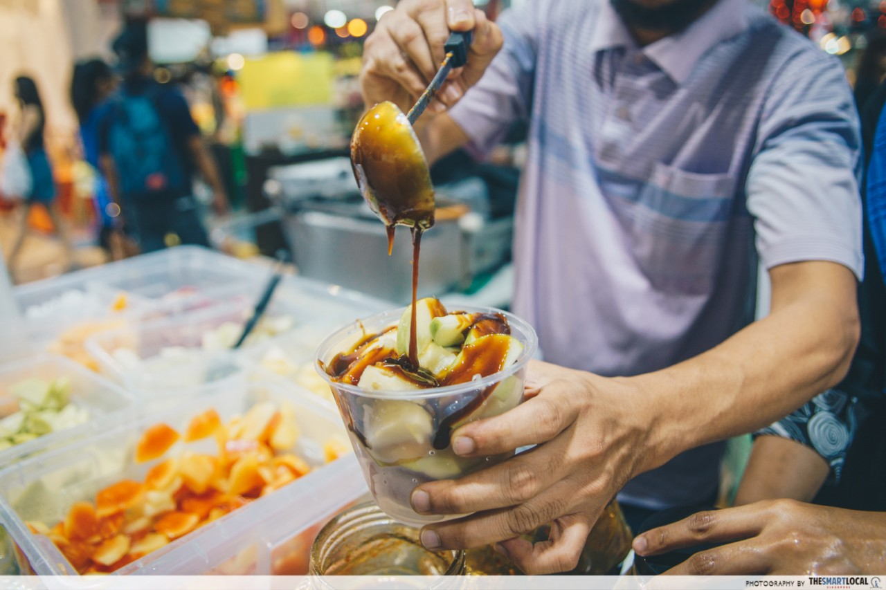 pouring sauce malay rojak