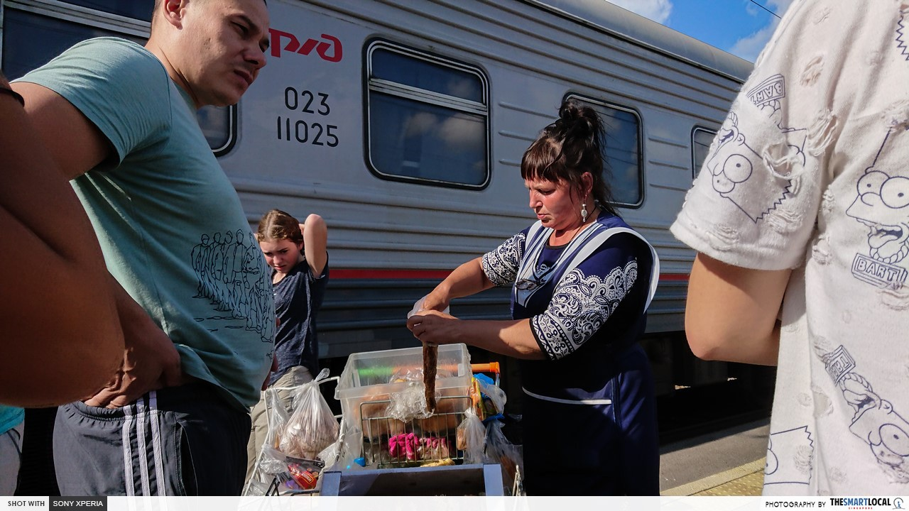 russian food vendors at the railway station trans manchurian train