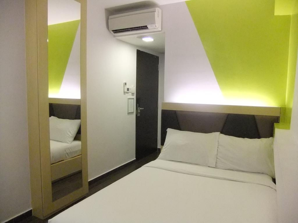 Hotels near clubs - simply furnished room