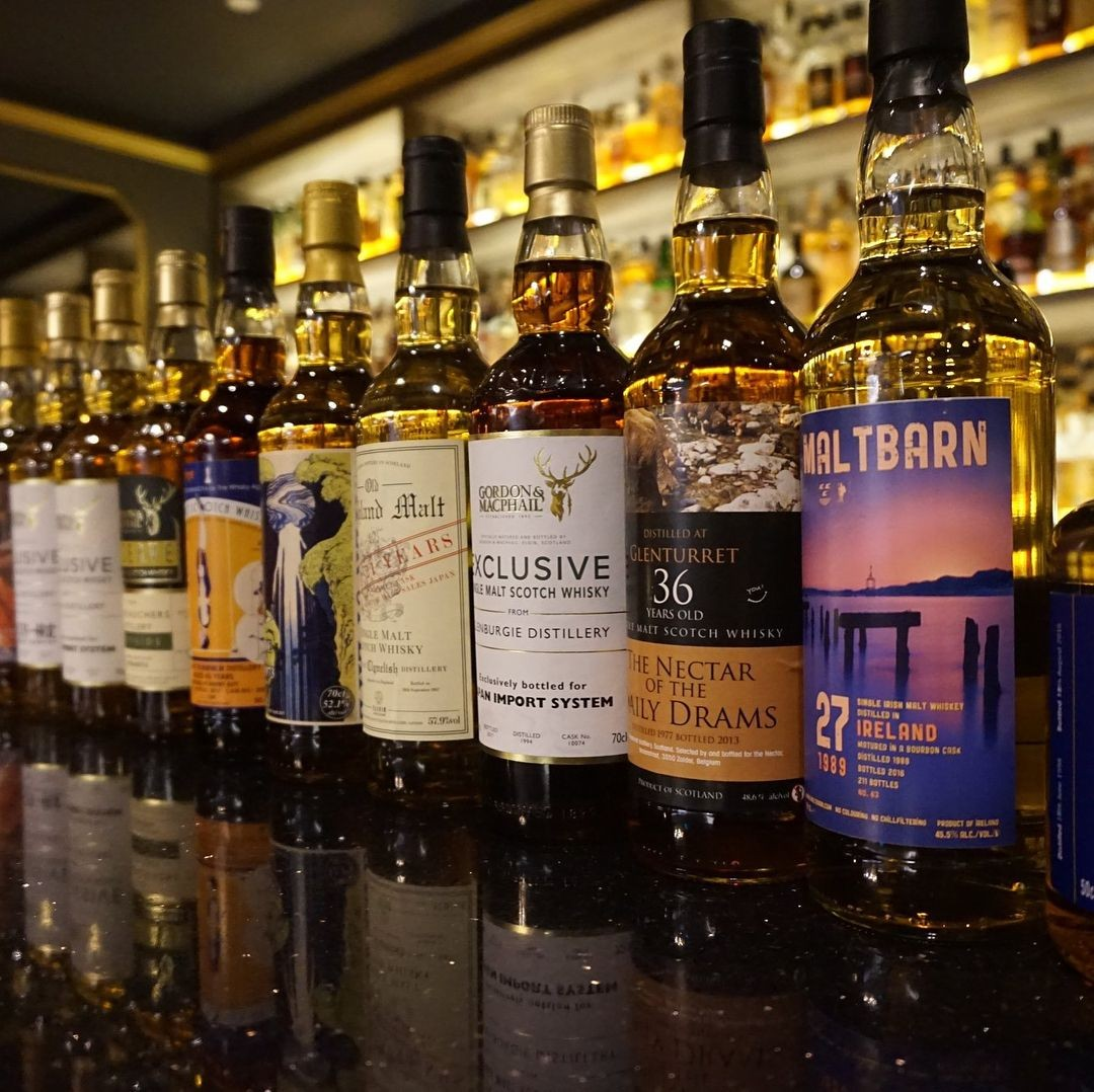 Bottles of rare whisky labels at The Writing Club