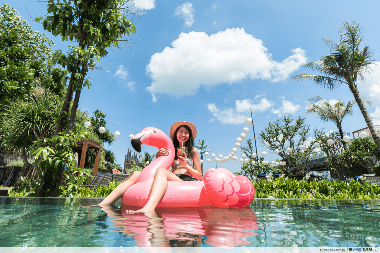 hotel indigo bali - flamingo float on main pool