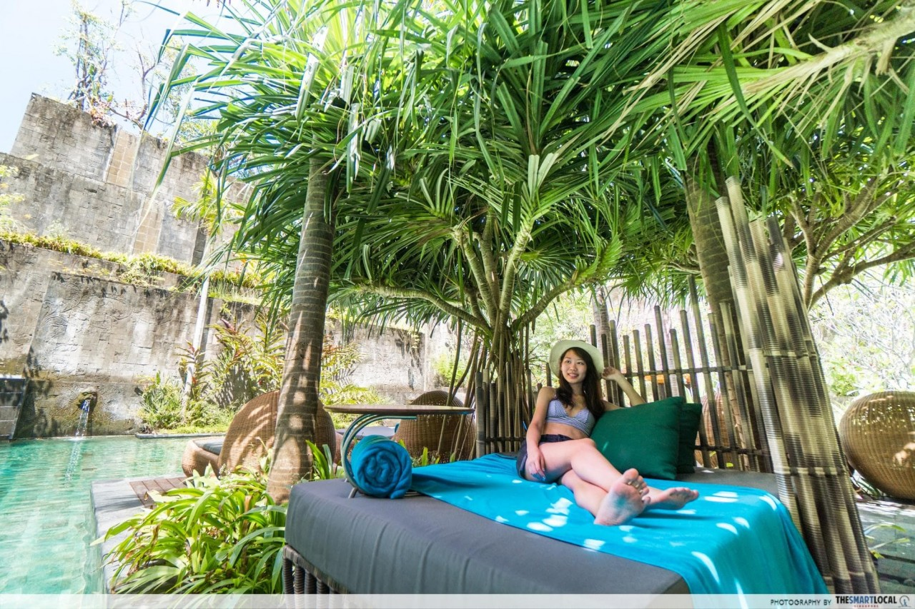 hotel indigo bali - bed beside secret garden pool