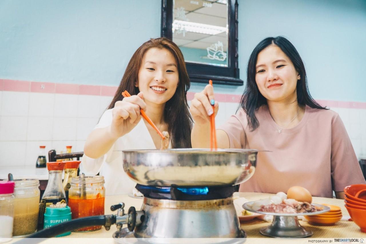 Enjoying chicken steamboat at Yet Con Hainanese Chicken Rice