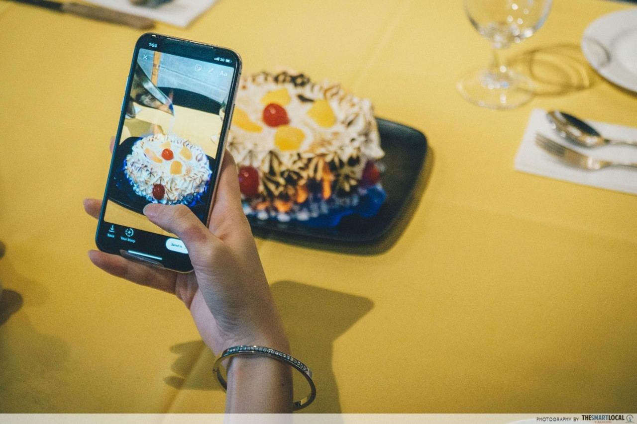 Taking a photo of Shashlik's Baked Alaska