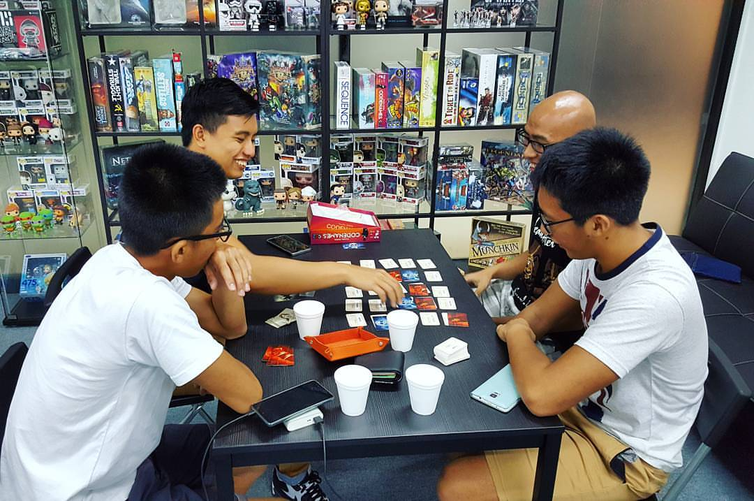 friends at team board game