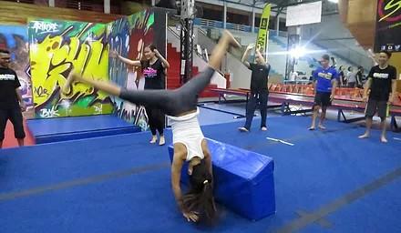 Trampoline park - gymkraft cart wheel girl gym