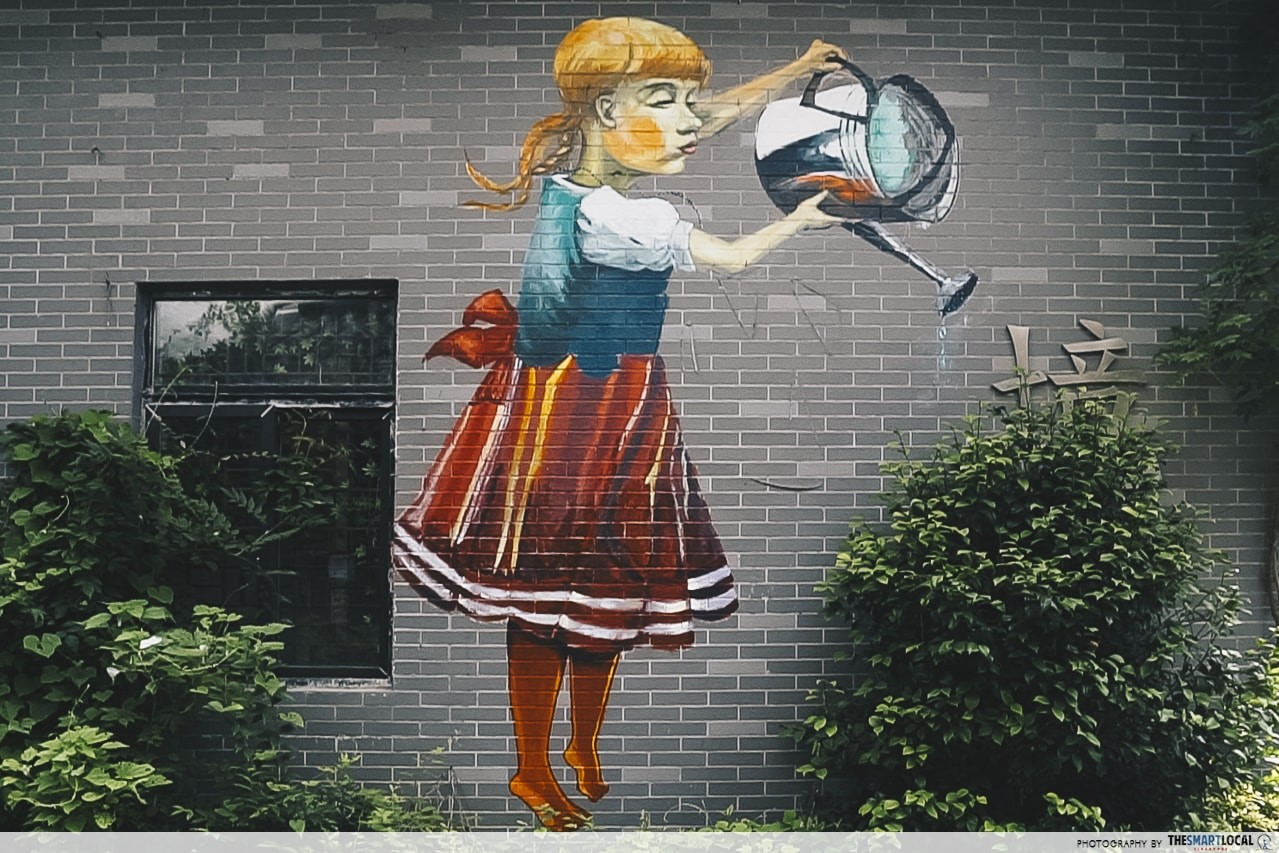 girl watering plants mural