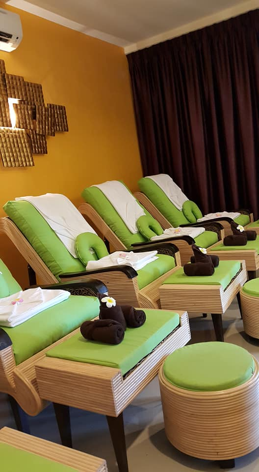 Row of massage chairs at Ancient Thai Herbal Spa & Beauty