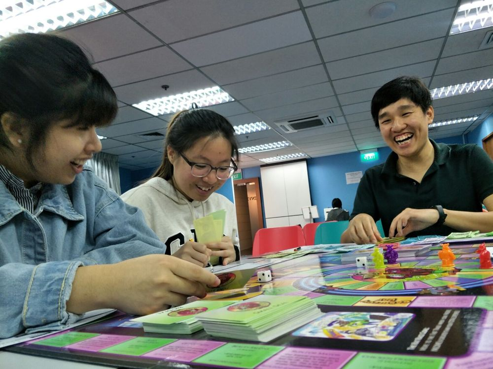 People playing boardgames at workshop