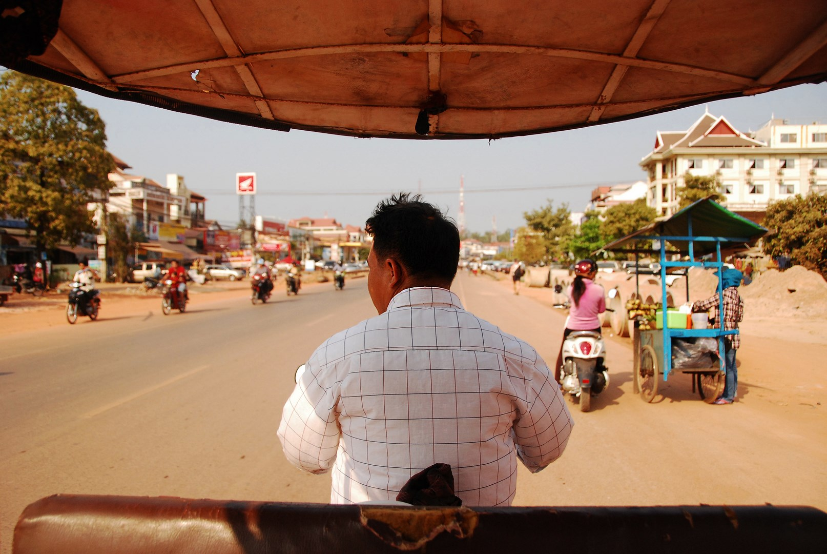The Real Cambodia - Explored Through Coach, Tuktuk, and Bicycle