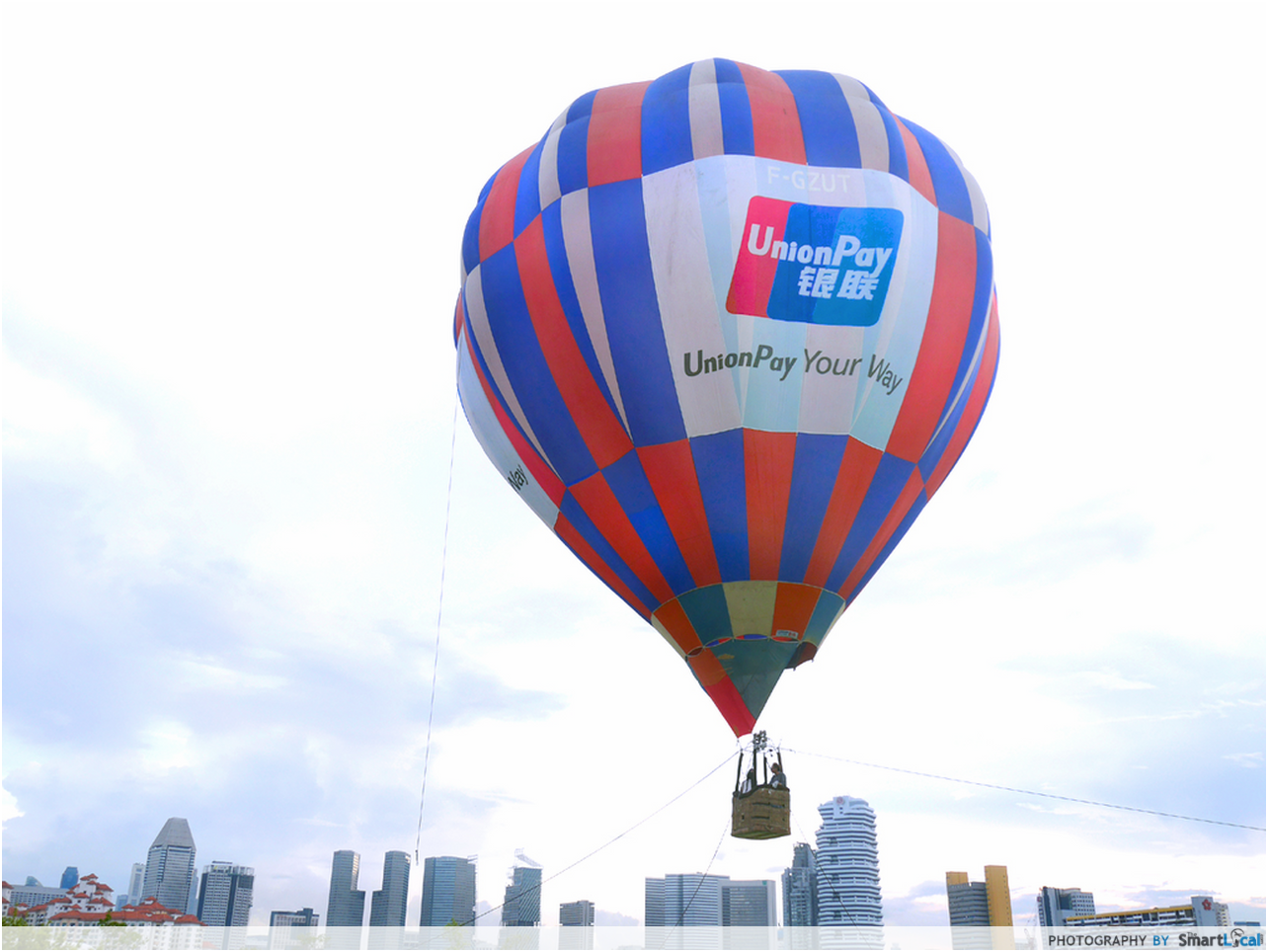 I hopped on the free hot air balloon ride at the sea games for Air balloon games