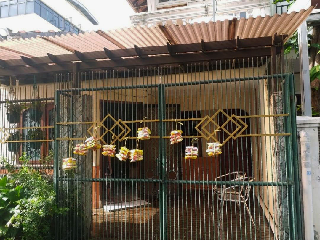 indomie packs hanging on a gate