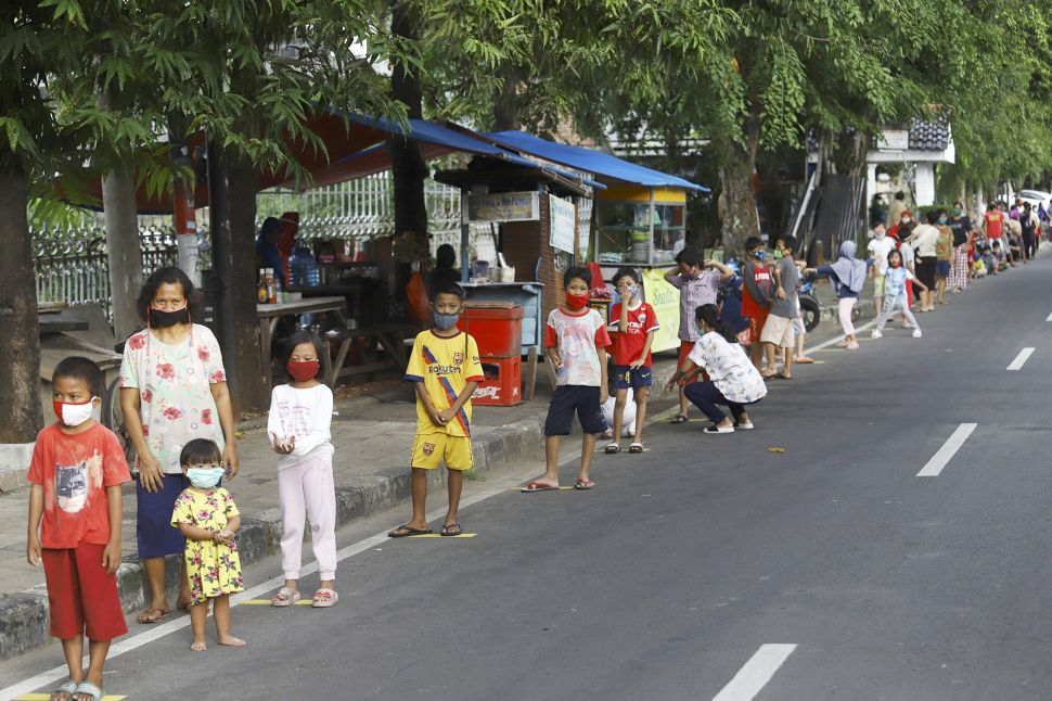 People waiting in line for food in Cempaka Putih
