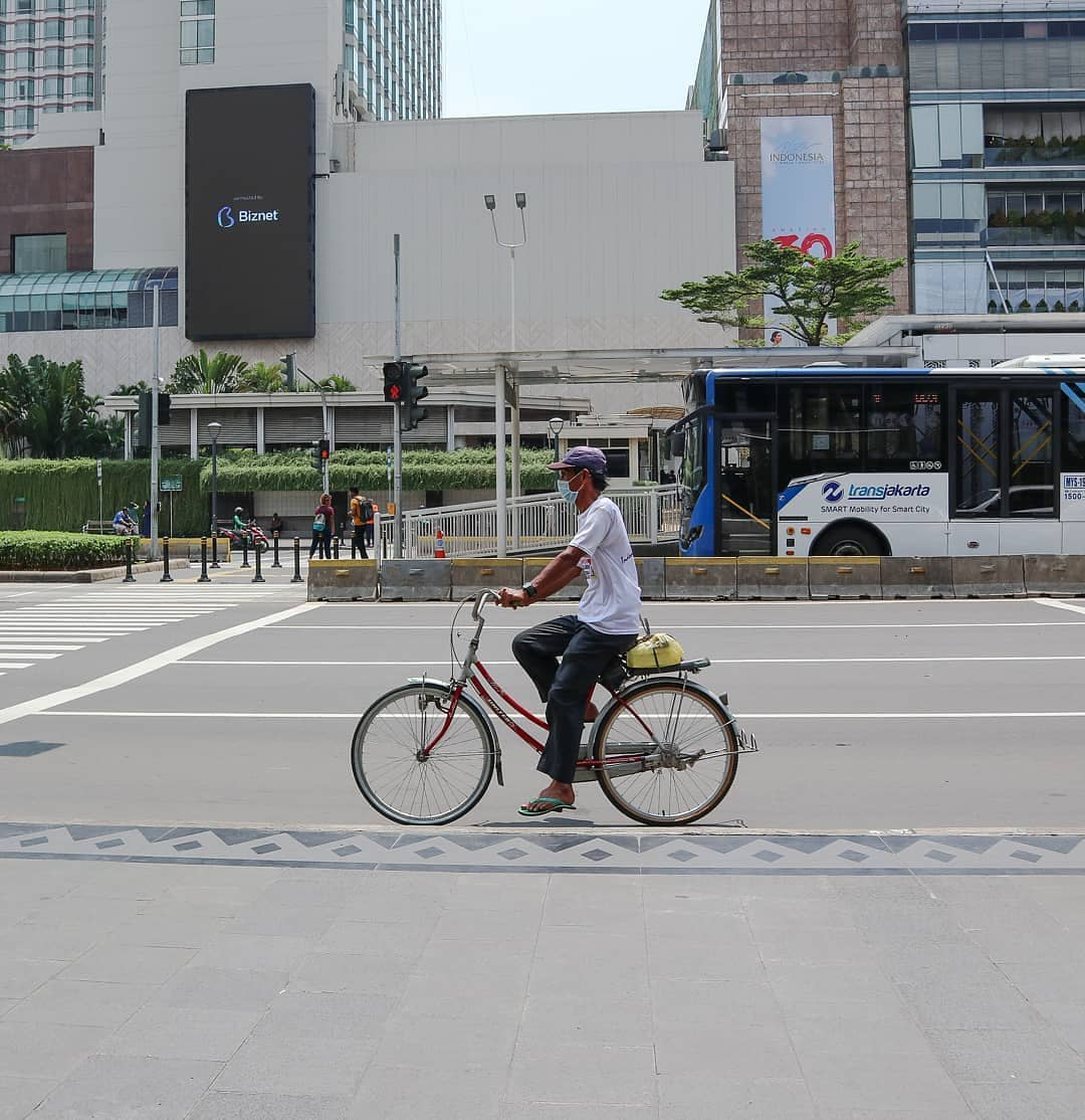 A man on his bike waits at the traffic light