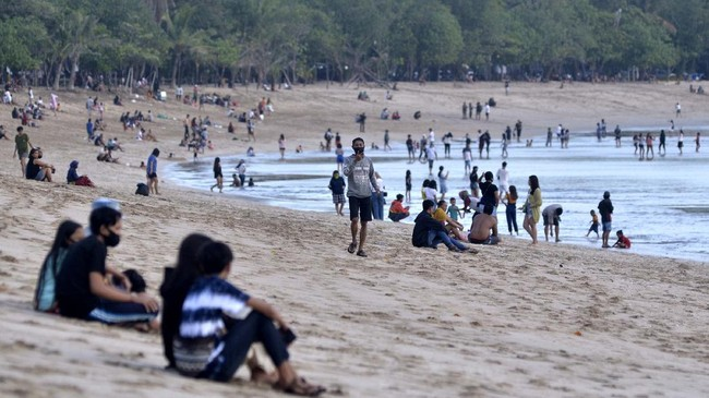 Bali beaches reopen - visitors in Kuta