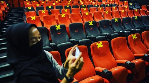 Indonesian cinemas to reopen on 29th July - woman at a movie theater