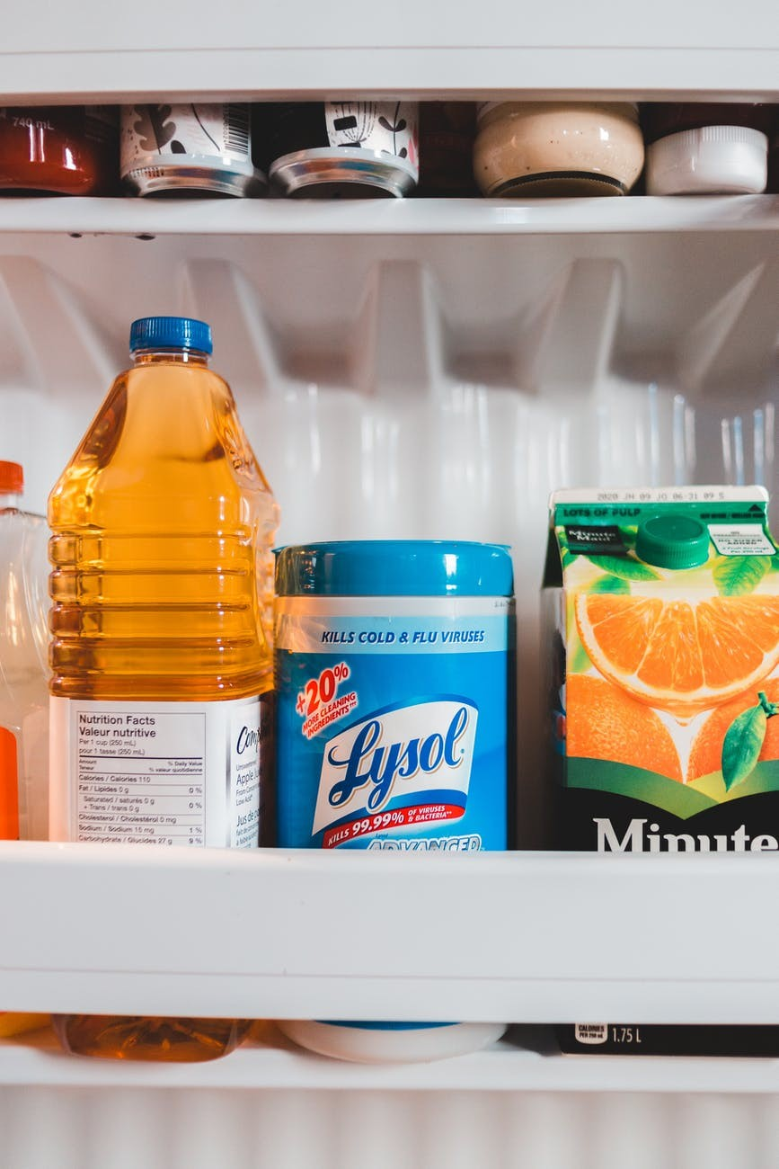 drinks and lysol in a fridge