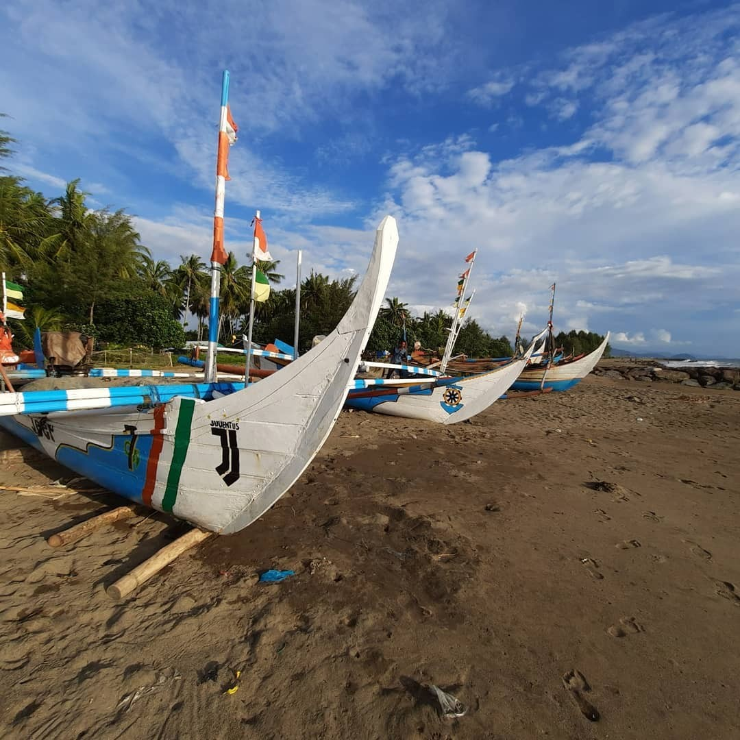 fishing boats on padang beach in west sumatra