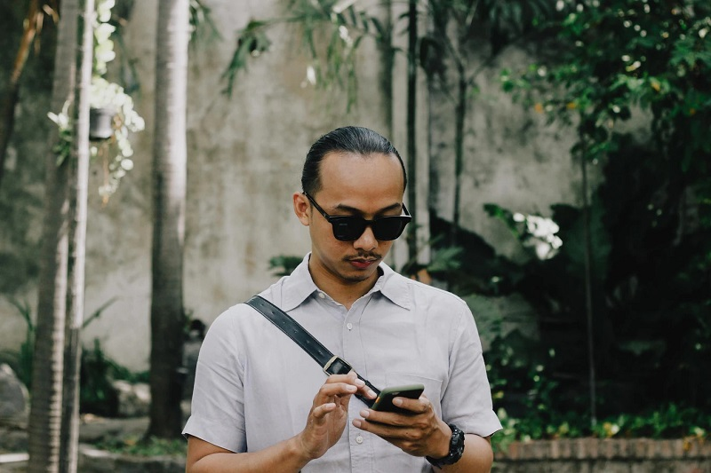 covid-19 vaccines in indonesia - man texting