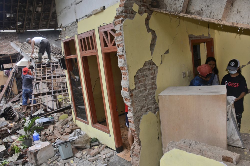 a house destroyed by an earthquake in malang