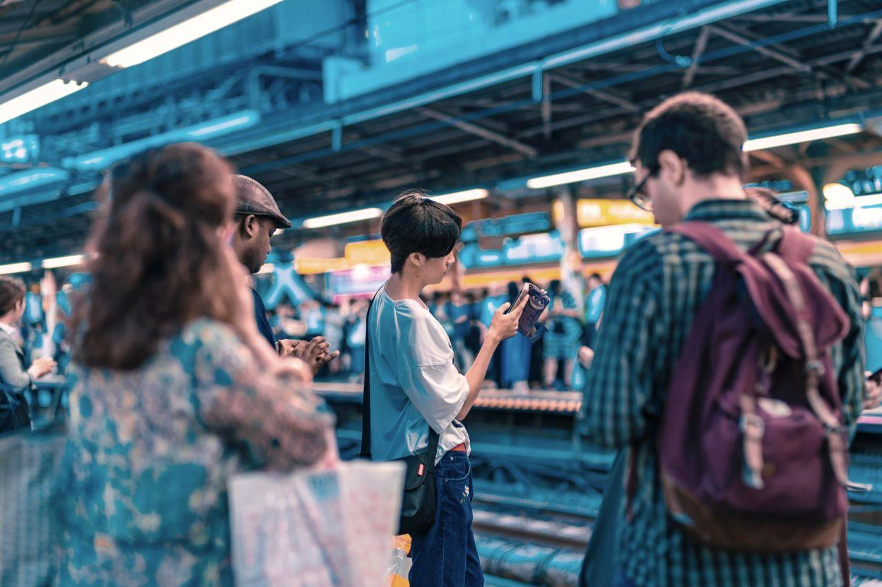 Using A Mobile Phone In A Train Station In Japan