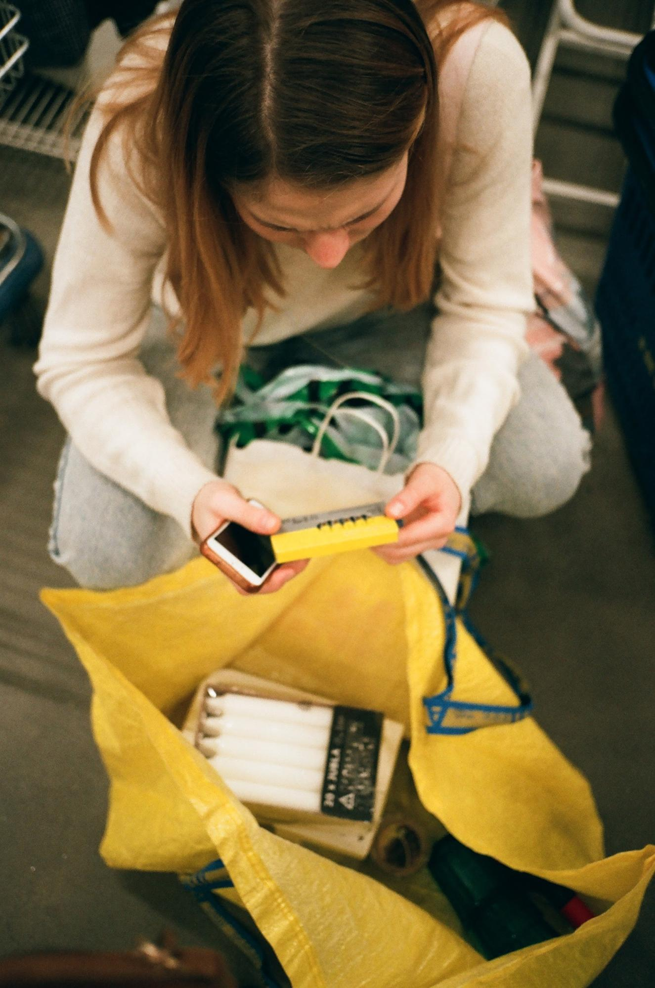A woman going through her shopping bag