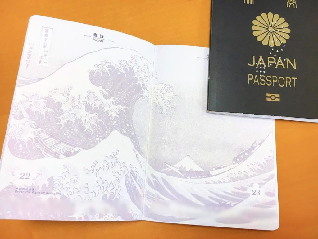 Calbee Hokusai Potato Chips - The Great Wave Off Kanagawa printed on pages of Japanese passport