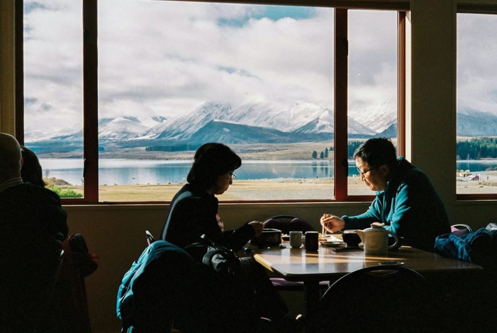 Useful Japanese tips - Japanese couple dining with Mount Fuji in the background