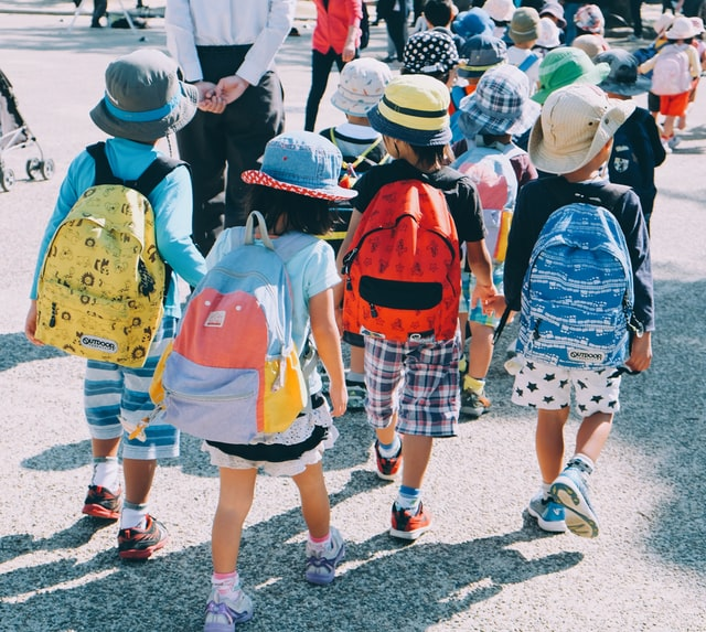 Useful Japanese tips - back view of kids in Japan