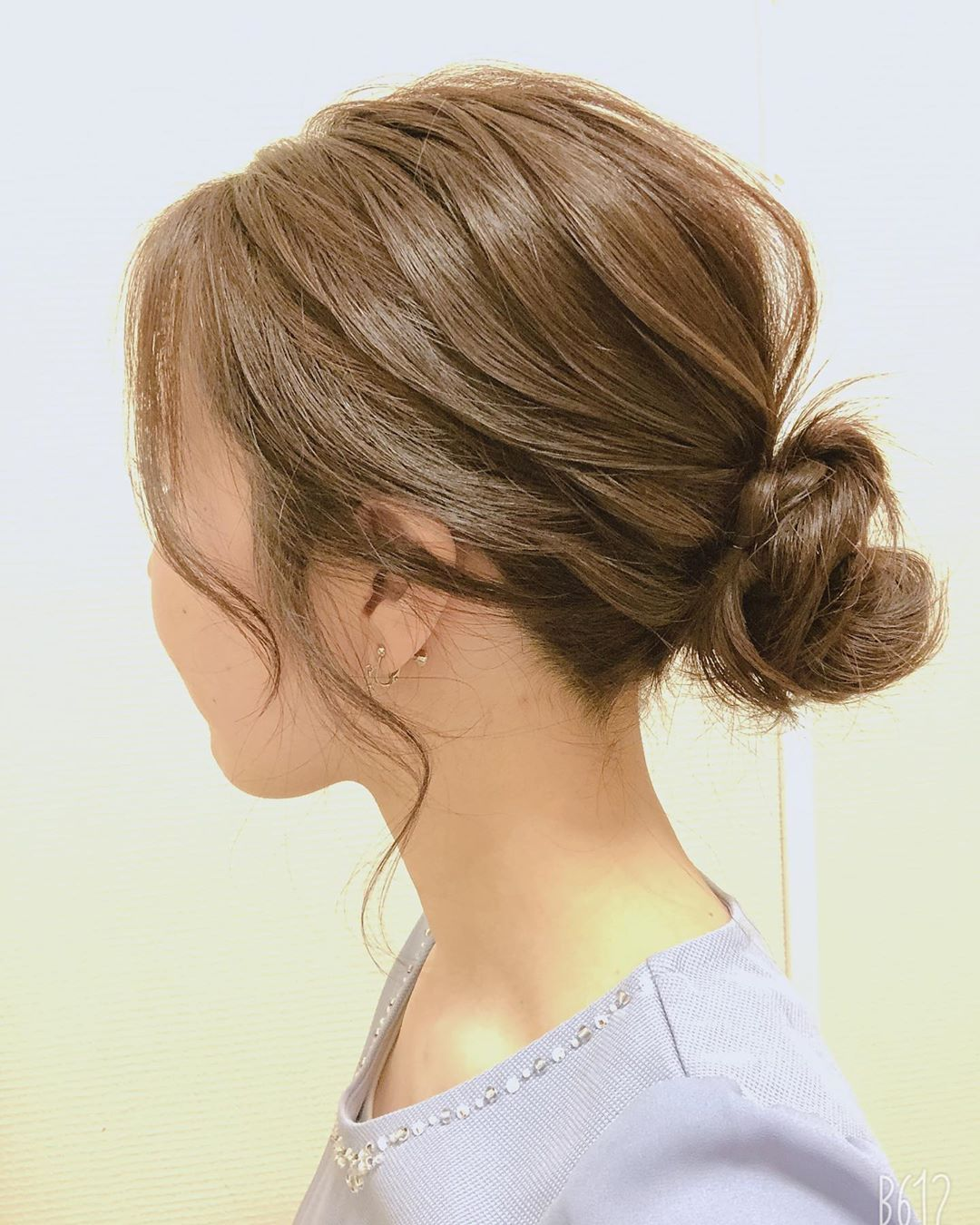 japanese hairstyles - textured messy bun with long side fringe side view
