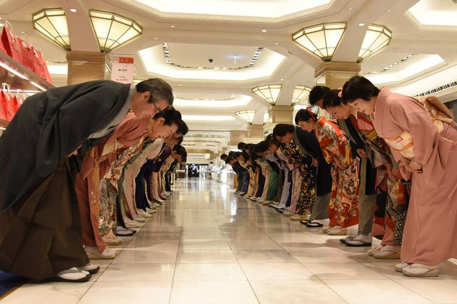 Japanese hospitality - staff at department store bowing