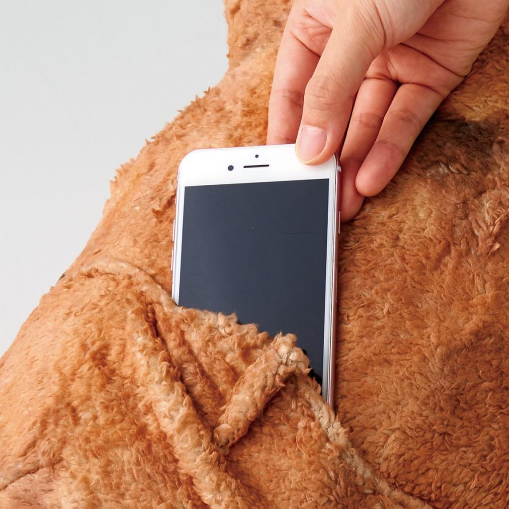 Felissimo's karaage cushions - sliding a smartphone into the cushion's pocket