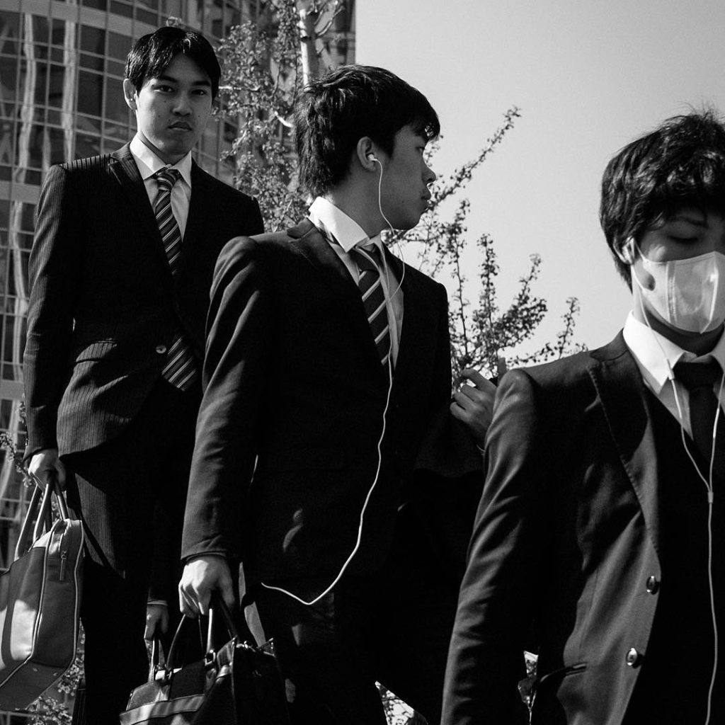 Mysteries in Japan - salarymen in black and white