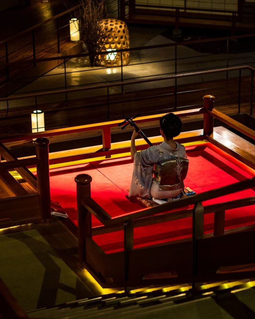 Demon Slayer Infinity Castle Ashinomaki Onsen Ookawaso - shamisen performance at the floating stage